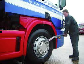 mechanic using a bus torque wrench